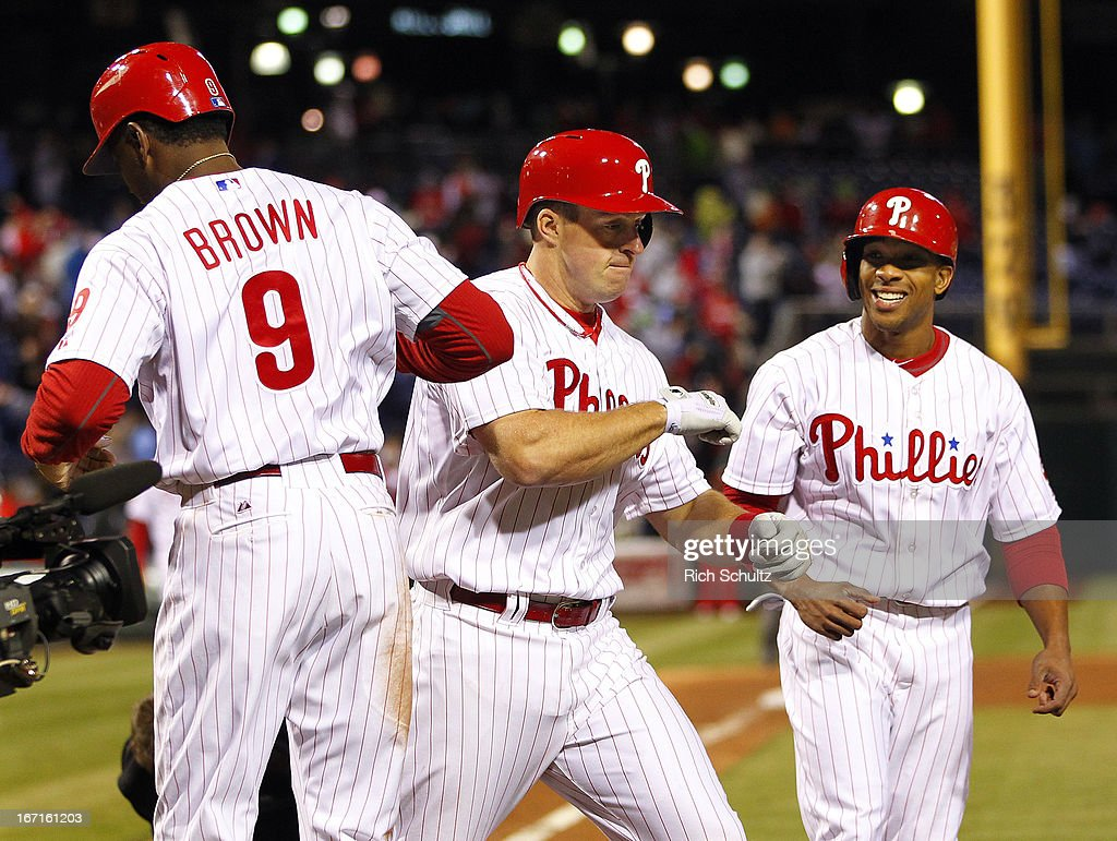 Erik Kratz #31 of the Philadelphia Phillies is congratulated by teammates Domonic Brown #9 and <a gi-track='captionPersonalityLinkClicked' href=/galleries/search?phrase=Ben+Revere&family=editorial&specificpeople=6826641 ng-click='$event.stopPropagation()'>Ben Revere</a> #2 after hitting a three run-home run in the eighth inning against of the St. Louis Cardinals in a MLB baseball game on April 21, 2013 at Citizens Bank Park in Philadelphia, Pennsylvania. The Phillies defeated the Cardinals 7-3.