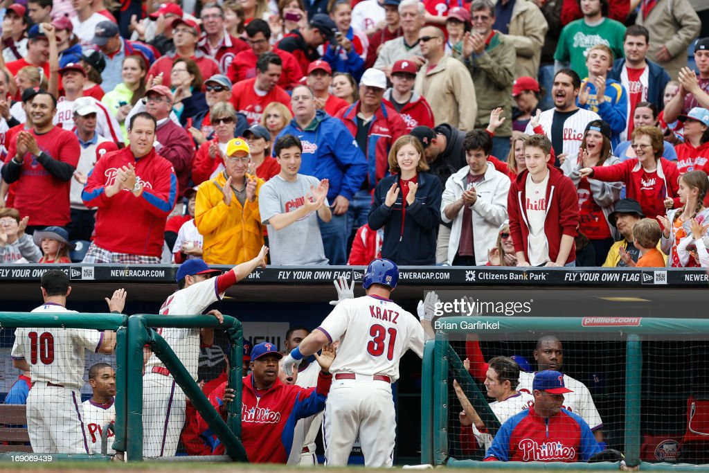 Erik Kratz #31 of the Philadelphia Phillies is congratulated by teammates after hitting a home run in the bottom of the ninth inning to tie the game against the Cincinnati Reds at Citizens Bank Park on May 19, 2013 in Philadelphia, Pennsylvania. The Phillies won 3-2.
