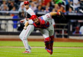 Erik Kratz of the Philadelphia Phillies throws out a New York Mets batter in the third inning at Citi Field on August 27 2013 in the Flushing...