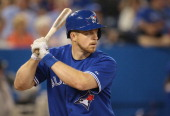 Erik Kratz of the Toronto Blue Jays bats during an MLB game against the Minnesota Twins on June 11 2014 at Rogers Centre in Toronto Ontario Canada