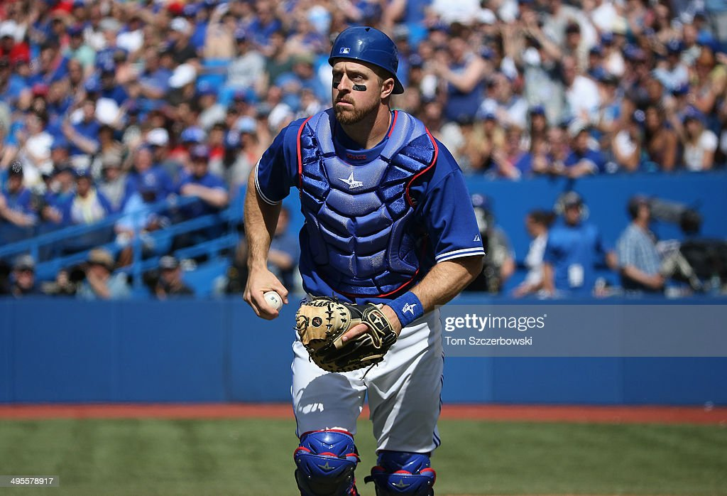 Erik Kratz of the Toronto Blue Jays during MLB game action against the Oakland Athletics on May 25 2014 at Rogers Centre in Toronto Ontario Canada