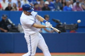 Erik Kratz of the Toronto Blue Jays hits a double in the third inning during MLB game action against the Boston Red Sox on July 21 2014 at Rogers...