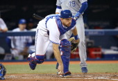 Erik Kratz of the Toronto Blue Jays pounces on a ball in the sixth inning during MLB game action against the Kansas City Royals on May 30 2014 at...