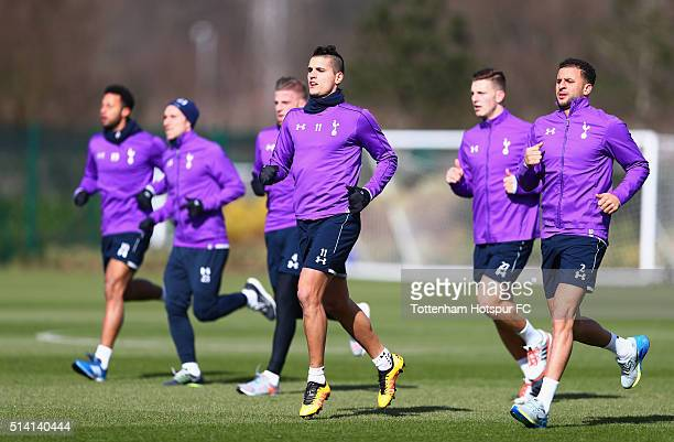 Erik Lamela and Kyle Walker of Tottenham Hotspur warm up during a training session at the club's training ground on March 7 2016 in Enfield England