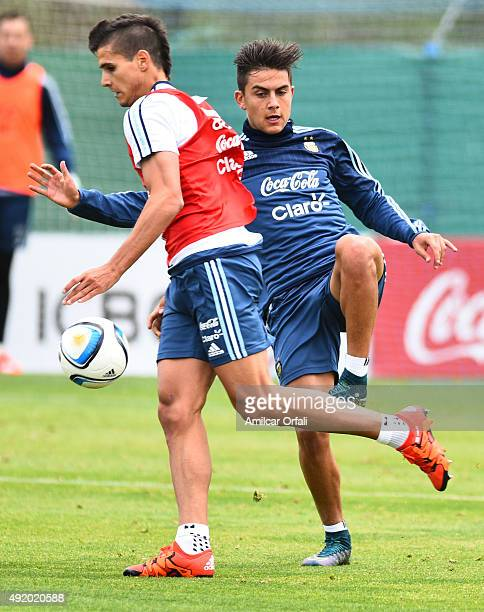 Erik Lamela and Paulo Dybala of Argentina fight for the ball during a training session on October 09 2015 in Ezeiza Argentina Argentina will face...