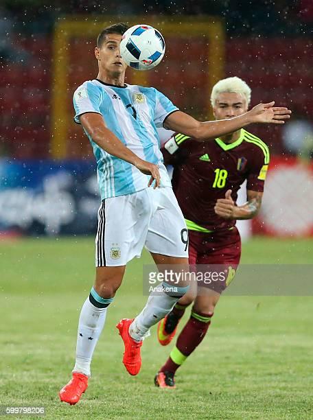Erik Lamela of Argentina fights for the ball with Adalberto Penaranda of Venezuela during a match between Venezuela and Argentina as part of FIFA...