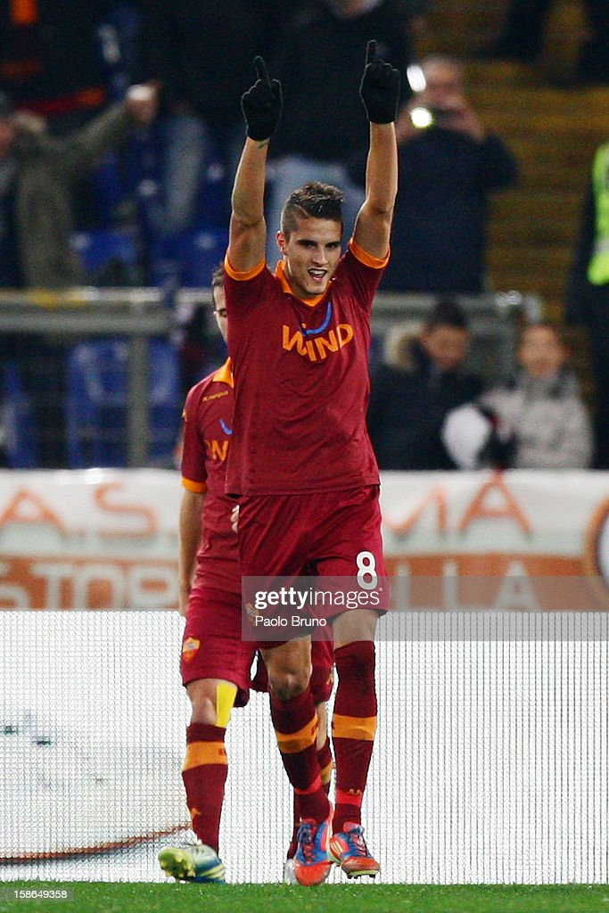 <a gi-track='captionPersonalityLinkClicked' href=/galleries/search?phrase=Erik+Lamela&family=editorial&specificpeople=7198648 ng-click='$event.stopPropagation()'>Erik Lamela</a> of AS Roma celebrates after scoring the fourth team's goal during the Serie A match between AS Roma and AC Milan at Stadio Olimpico on December 22, 2012 in Rome, Italy.