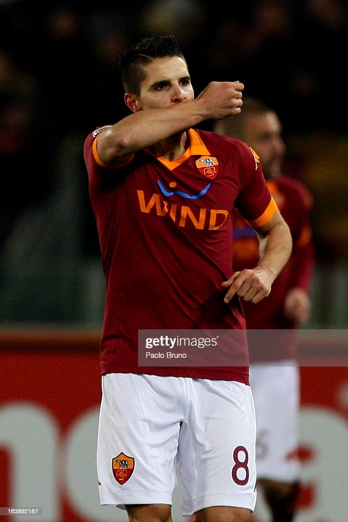 <a gi-track='captionPersonalityLinkClicked' href=/galleries/search?phrase=Erik+Lamela&family=editorial&specificpeople=7198648 ng-click='$event.stopPropagation()'>Erik Lamela</a> of AS Roma celebrates after scoring the opening goal during the Serie A match between AS Roma and Parma FC at Stadio Olimpico on March 17, 2013 in Rome, Italy.