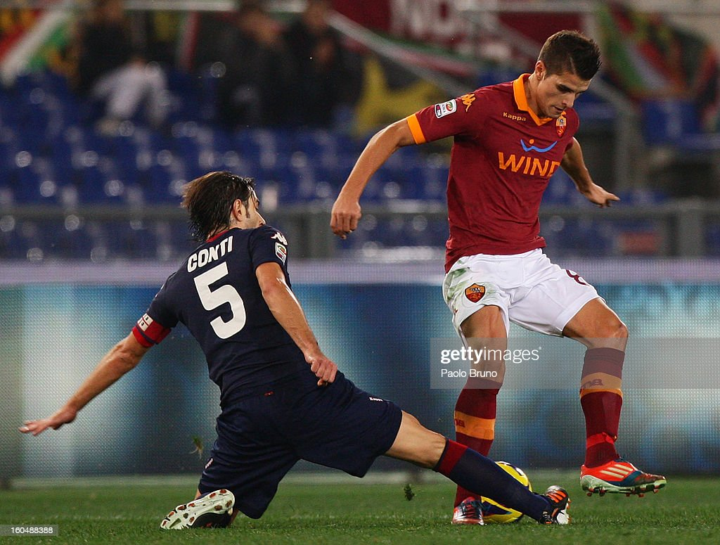 Erik Lamela (R) of AS Roma competes for the ball with Daniele Conti of Cagliari Calcio during the Serie A match between AS Roma and Cagliari Calcio at Stadio Olimpico on February 1, 2013 in Rome, Italy.