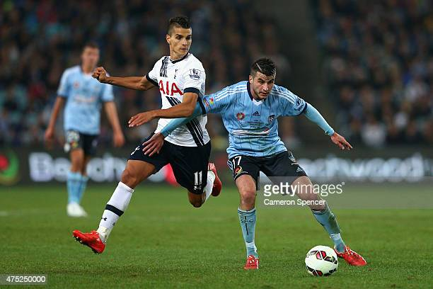 Erik Lamela of Hotspur and Terry Antonis of Sydney FC contest the ball during the international friendly match between Sydney FC and Tottenham Spurs...