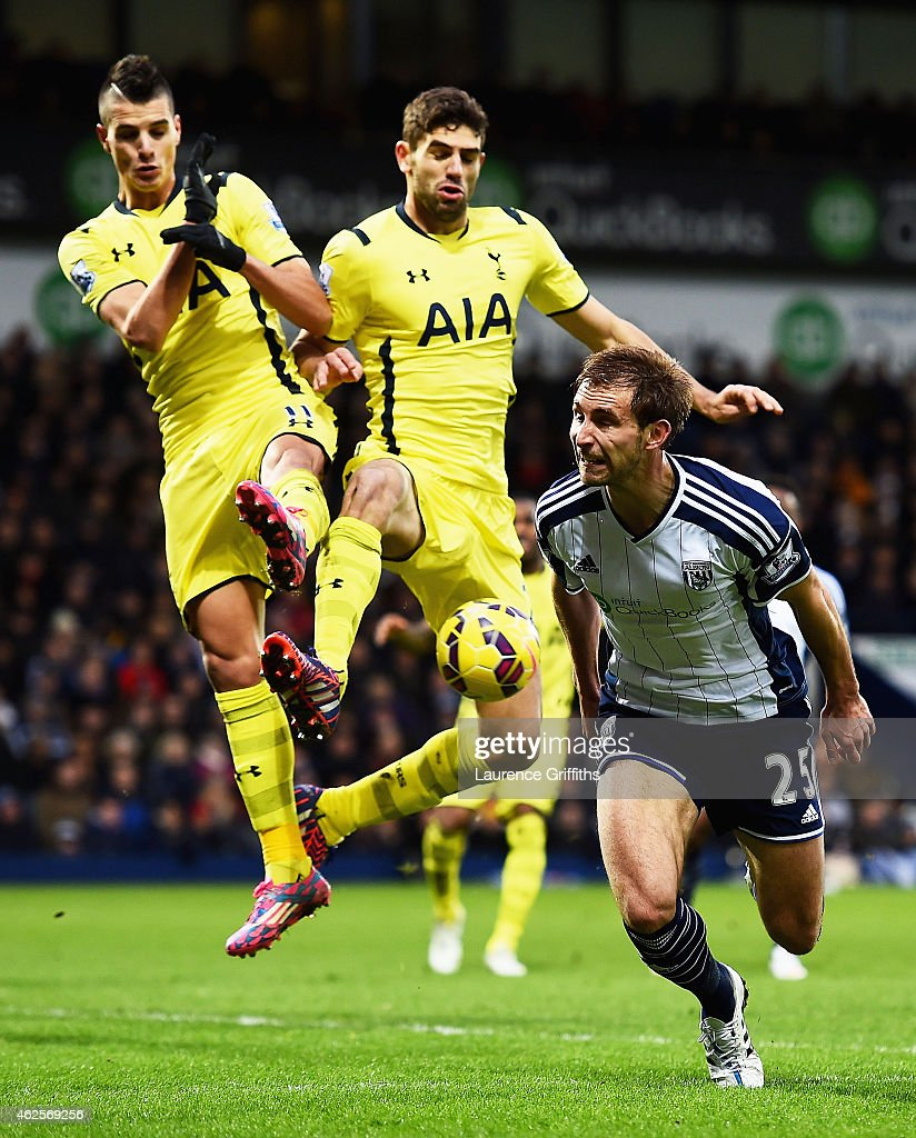 Erik Lamela of Spurs and Federico Fazio of Spurs block Craig Dawson of West Brom during the Barclays Premier League match between West Bromwich Albion and Tottenham Hotspur at The Hawthorns on January 31, 2015 in West Bromwich, England.