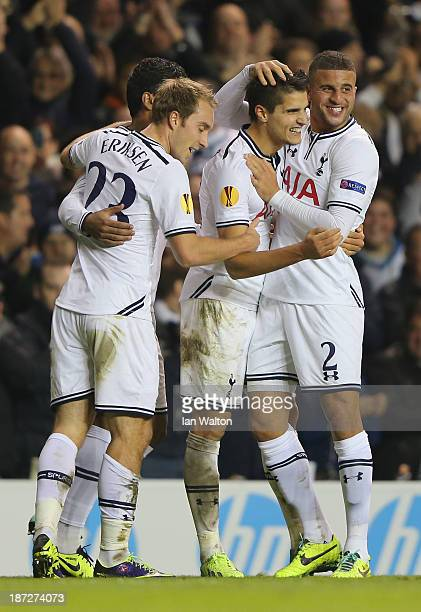 Erik Lamela of Spurs celebrates scoring their first goal with Kyle Walker and Christian Eriksen of Spurs during the UEFA Europa League Group K match...