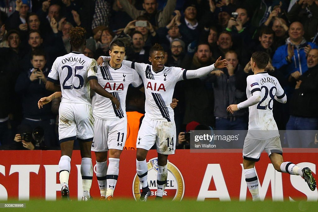 Erik Lamela #11 of Spurs is congratulated by teammates after scoring his team's third goal and completing his hat trick during the UEFA Europa League Group J match between Tottenham Hotspur and AS Monaco at White Hart Lane on December 10, 2015 in London, United Kingdom.