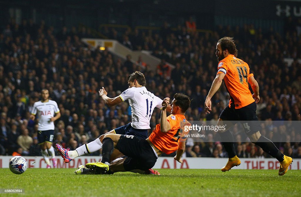 <a gi-track='captionPersonalityLinkClicked' href=/galleries/search?phrase=Erik+Lamela&family=editorial&specificpeople=7198648 ng-click='$event.stopPropagation()'>Erik Lamela</a> of Spurs scores the opening goal under pressure from Lewis Dunk of Brighton during the Capital One Cup Fourth Round match Tottenham Hotspur and Brighton & Hove Albion at White Hart Lane on October 29, 2014 in London, England.