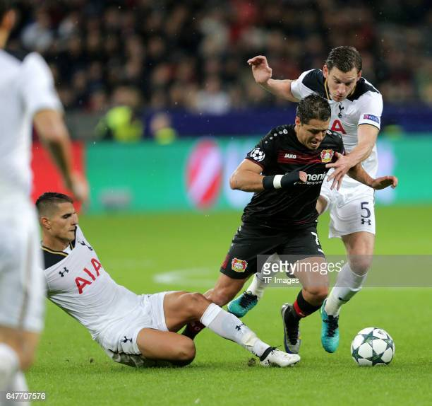Erik Lamela of Tottenham and Javier Hernandez of Leverkusen and Jan Vertonghen of Tottenham battle for the ball during the UEFA Champions League...