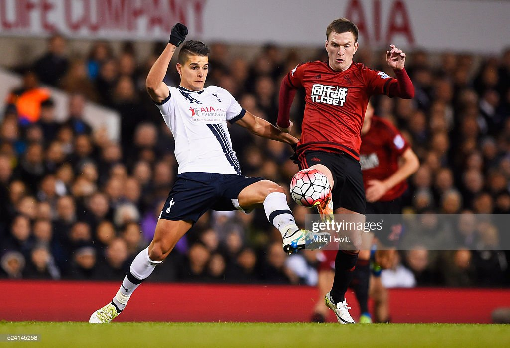 Erik Lamela of Tottenham Hotspur and Craig Gardner of West Bromwich Albion battle for the ball during the Barclays Premier League match between Tottenham Hotspur and West Bromwich Albion at White Hart Lane on April 25, 2016 in London, England.