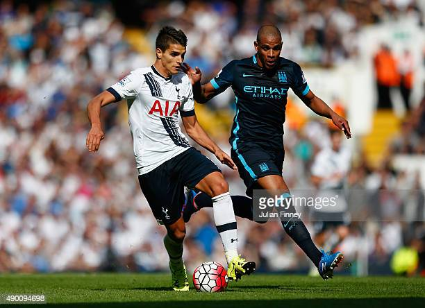 Erik Lamela of Tottenham Hotspur and Fernando of Manchester City compete for the ball during the Barclays Premier League match between Tottenham...