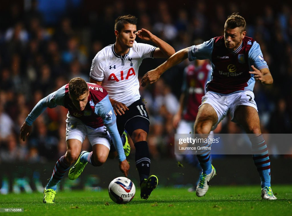<a gi-track='captionPersonalityLinkClicked' href=/galleries/search?phrase=Erik+Lamela&family=editorial&specificpeople=7198648 ng-click='$event.stopPropagation()'>Erik Lamela</a> of Tottenham Hotspur battles with Joe Bennett and Nathan Baker of Aston Villa during the Capital One Cup third round match between Aston Villa and Tottenham Hotspur at Villa Park on September 24, 2013 in Birmingham, England.