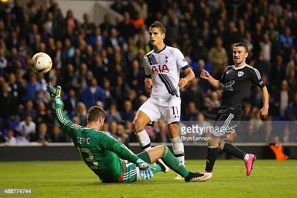 Erik Lamela of Tottenham Hotspur beats goalkeeper Ibrahim Sehic of FK Qarabag to score their third goal during the UEFA Europa League Group J match...