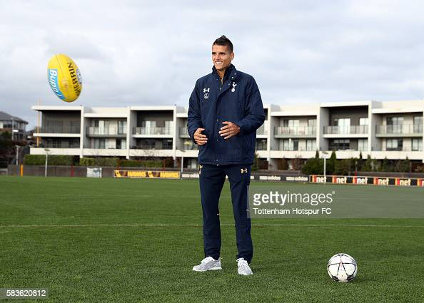 Erik Lamela of Tottenham Hotspur is seen with an aussie rule football during a Tottenham Hotspur player visit to the Hawthorn Hawks AFL team at...