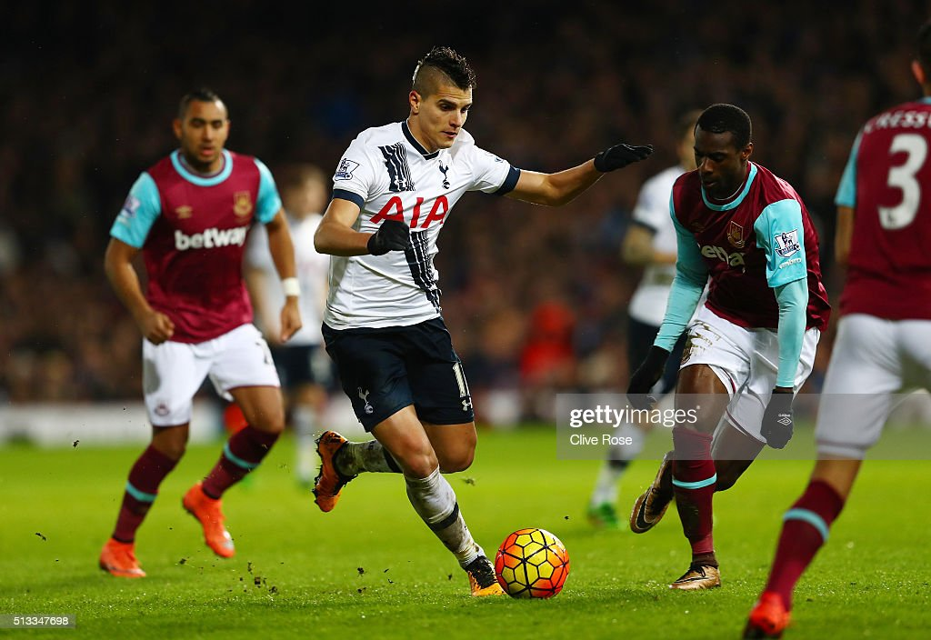 Erik Lamela of Tottenham Hotspur runs with the ball at Pedro Mba Obiang of West Ham United during the Barclays Premier League match between West Ham United and Tottenham Hotspur at Boleyn Ground on March 2, 2016 in London, England.
