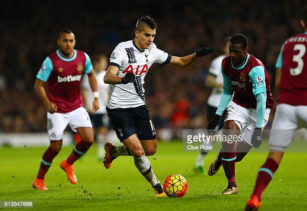 Erik Lamela of Tottenham Hotspur runs with the ball at Pedro Mba Obiang of West Ham United during the Barclays Premier League match between West Ham...