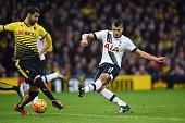 Erik Lamela of Tottenham Hotspur scores his team's first goal during the Barclays Premier League match between Watford and Tottenham Hotspur at...