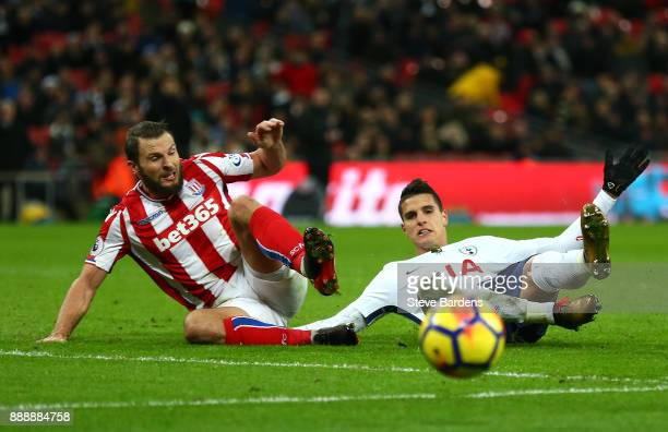 Erik Lamela of Tottenham Hotspur shoots wide while under pressure from Erik Pieters of Stoke City during the Premier League match between Tottenham...