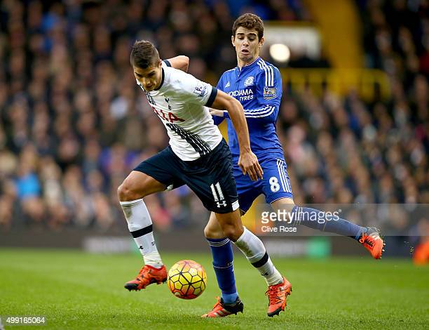 Erik Lamela of Tottenham Hotspur takes on Oscar of Chelsea during the Barclays Premier League match between Tottenham Hotspur and Chelsea at White...