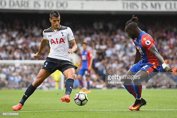 Erik Lamela of Tottenham Hotspur takes the ball past Pape N'Diaye Souaré of Crystal Palace during the Premier League match between Tottenham Hotspur...