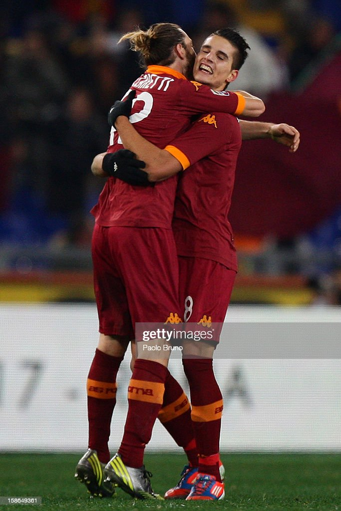 Erik Lamela (R) with his teammate Federico Balzaretti of AS Roma celebrates after scoring the fourth team's goal during the Serie A match between AS Roma and AC Milan at Stadio Olimpico on December 22, 2012 in Rome, Italy.