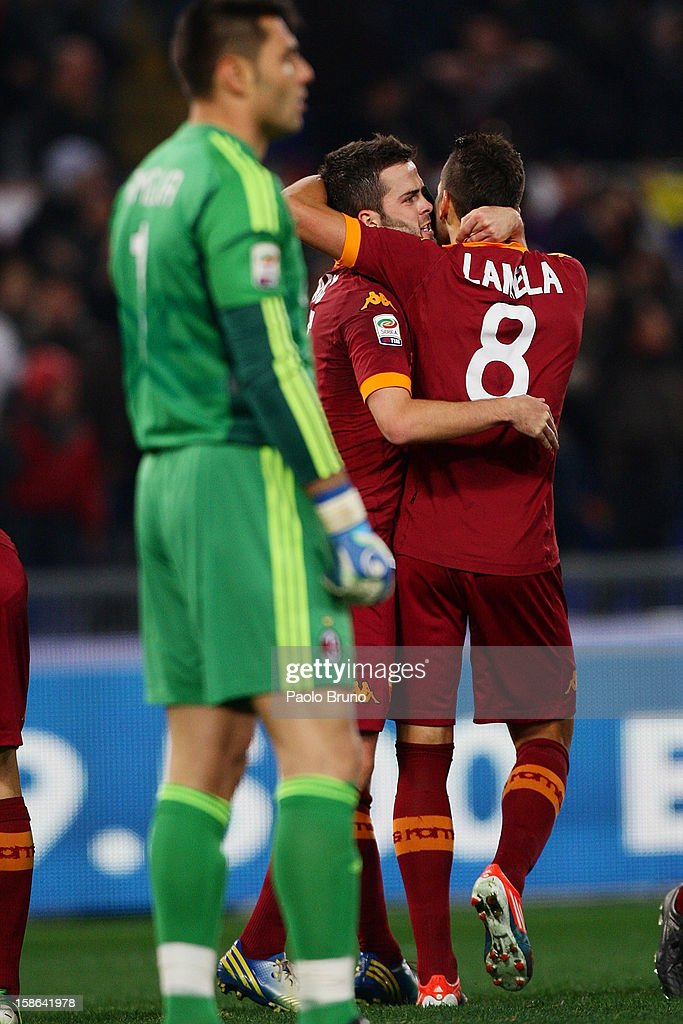 Erik Lamela (R) with his teammate Miralem Pjanic of AS Roma celebrates after scoring the third team's goal during the Serie A match between AS Roma and AC Milan at Stadio Olimpico on December 22, 2012 in Rome, Italy.