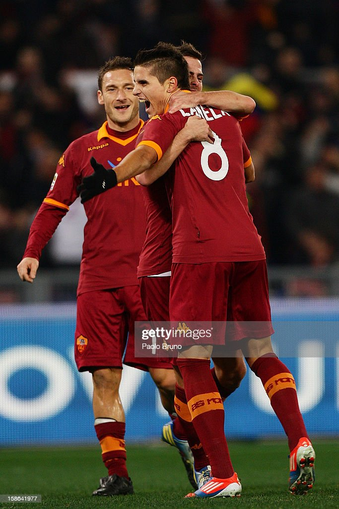 <a gi-track='captionPersonalityLinkClicked' href=/galleries/search?phrase=Erik+Lamela&family=editorial&specificpeople=7198648 ng-click='$event.stopPropagation()'>Erik Lamela</a> (R) with his teammates of AS Roma celebrates after scoring the third team's goal during the Serie A match between AS Roma and AC Milan at Stadio Olimpico on December 22, 2012 in Rome, Italy.