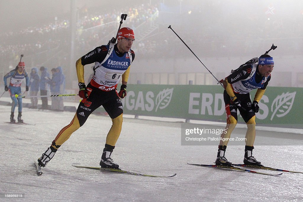 Erik Lesser of Germany, <a gi-track='captionPersonalityLinkClicked' href=/galleries/search?phrase=Arnd+Peiffer&family=editorial&specificpeople=5658801 ng-click='$event.stopPropagation()'>Arnd Peiffer</a> of Germany takes 3rd place competes during the IBU Biathlon World Cup Men's Relay on January 04, 2013 in Oberhof, Germany.