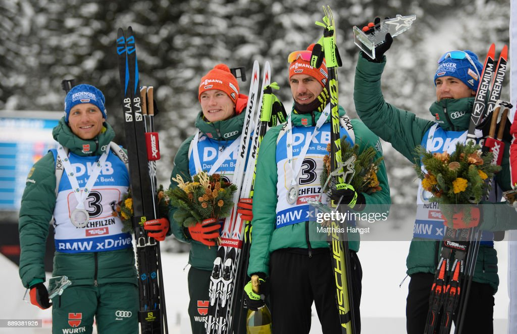 Erik Lesser of Germany, Benedikt Doll of Germany, Arnd Peiffer of Germany and Simon Schempp of Germany celebrate on the podium after the Men's 4x7.5km relay competition of the BMW IBU World Cup Biathlon on December 10, 2017 in Hochfilzen, Austria.