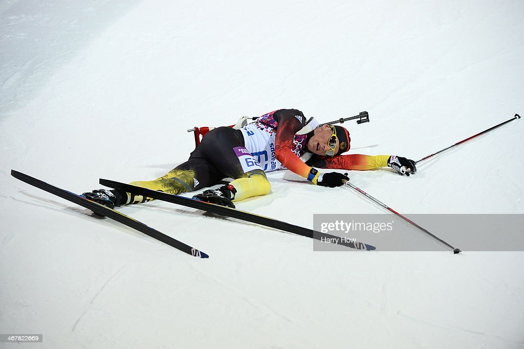 <a gi-track='captionPersonalityLinkClicked' href=/galleries/search?phrase=Erik+Lesser&family=editorial&specificpeople=6837118 ng-click='$event.stopPropagation()'>Erik Lesser</a> of Germany collapses on the snow after competing in the Men's Sprint 10 km during day one of the Sochi 2014 Winter Olympics at Laura Cross-country Ski & Biathlon Center on February 8, 2014 in Sochi, Russia.