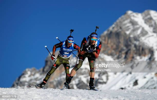 Erik Lesser of Germany leads Simon Schempp of Germany during the Men's 20km Individual competition of the IBU World Championships Biathlon 2017 at...
