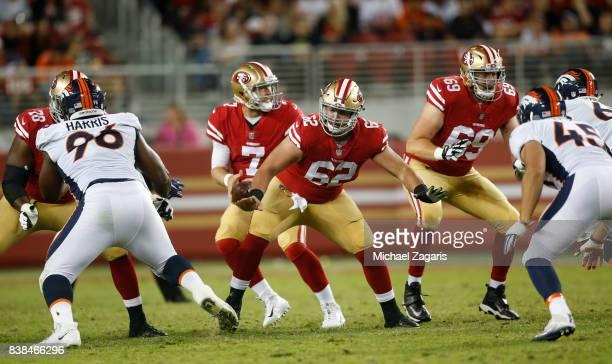 Erik Magnuson and Andrew Gardner#69 of the San Francisco 49ers block for Matt Barkley during the game against the Denver Broncos at Levi Stadium on...