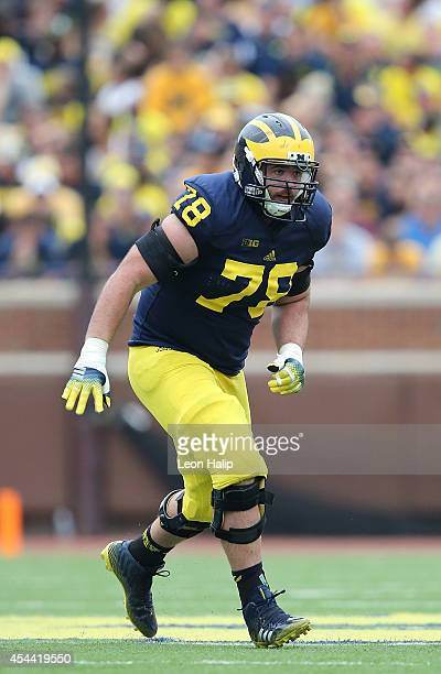 Erik Magnuson of the Michigan Wolverines looks to make the block during the second half of the game against the Appalachian State Mountaineers on...