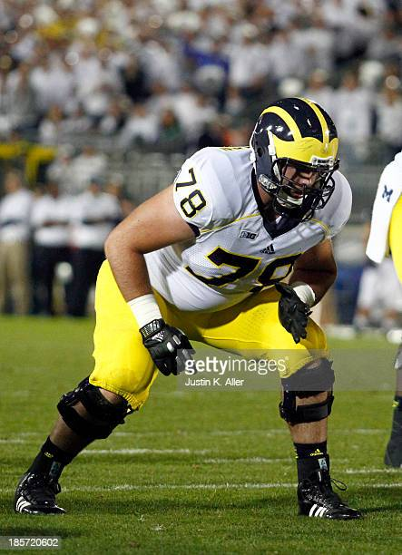 Erik Magnuson of the Michigan Wolverines plays against the Penn State Nittany Lions during the game on October 12 2013 at Beaver Stadium in State...