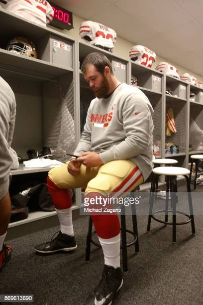Erik Magnuson of the San Francisco 49ers sits in the locker room prior to the game against the Philadelphia Eagles at Lincoln Financial Field on...
