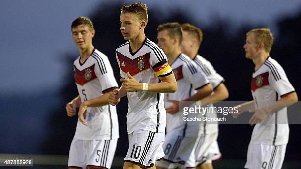 Erik Majetschak of Germany celebrates with team mates after scoring his team's fourth goal during the U16 international friendly match between...