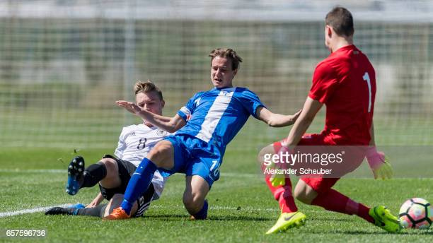 Erik Majetschak of Germany challenges Wille Oehman of Finland during the UEFA U17 elite round match between Germany and Finland on March 25 2017 in...