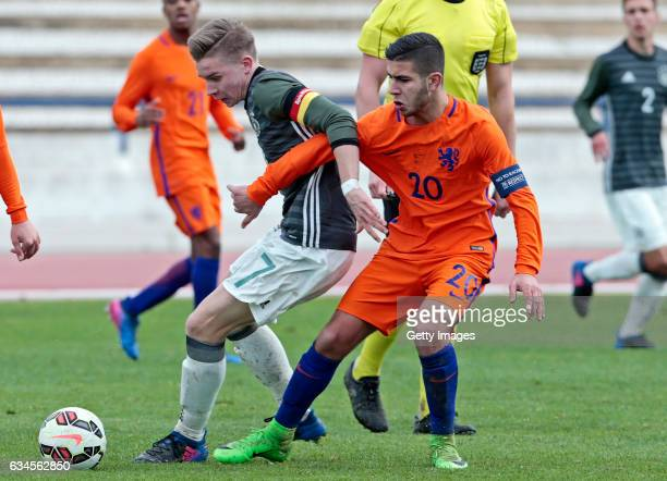 Erik Majetschak of Germany U17 challenges Achraf el Bouchatoui of Netherlands U17 during the Algarve International Tournament U17 Match between...
