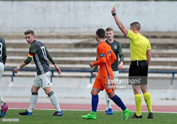 Erik Majetschak of Germany U17 sees Yellow card by Rovert Jones after fault over Achraf el Bouchatoui of Netherlands U17 during the Algarve...