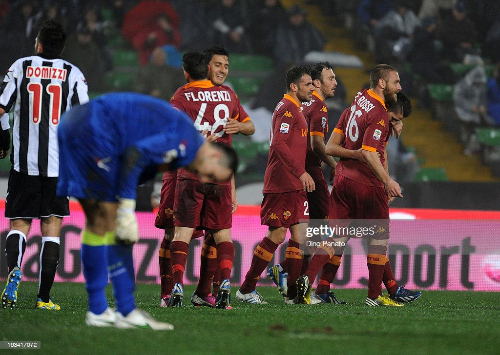 Erik Manuel Lamela (C) celebrates after scoring his opening goal with teams mate during the Serie A match between Udinese Calcio and AS Roma at Stadio Friuli on March 9, 2013 in Udine, Italy.