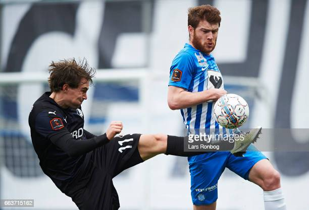 Erik Marxen of Randers FC and Budu Zivzivadze of Esbjerg fB compete for the ball during the Danish Alka Superliga match between Esbjerg fB and...