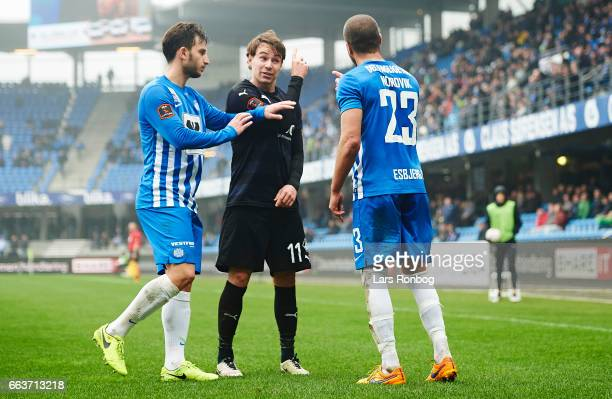 Erik Marxen of Randers FC in discussion with Andreas Nordvik of Esbjerg fB during the Danish Alka Superliga match between Esbjerg fB and Randers FC...
