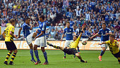 Erik Maxim Choupo Moting of Schalke scored his teams second goal during the Bundesliga match between FC Schalke 04 and Borussia Dortmund at Veltins...