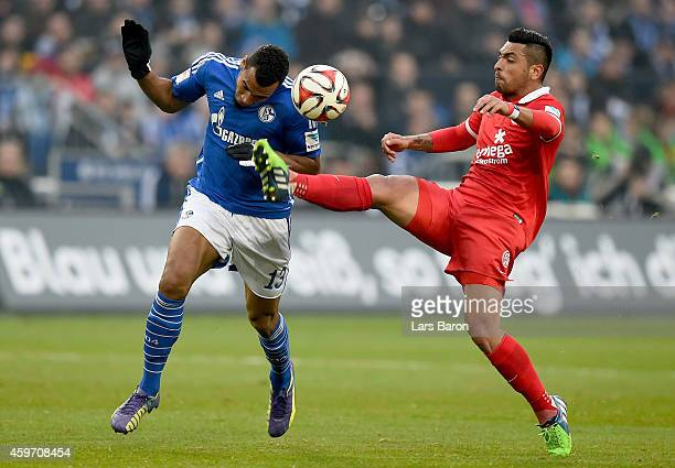 Erik Maxim ChoupoMoting of FC Schalke 04 is challenged by Gonzalo Jara of FSV Mainz 05 during the Bundesliga match between FC Schalke 04 and FSV...